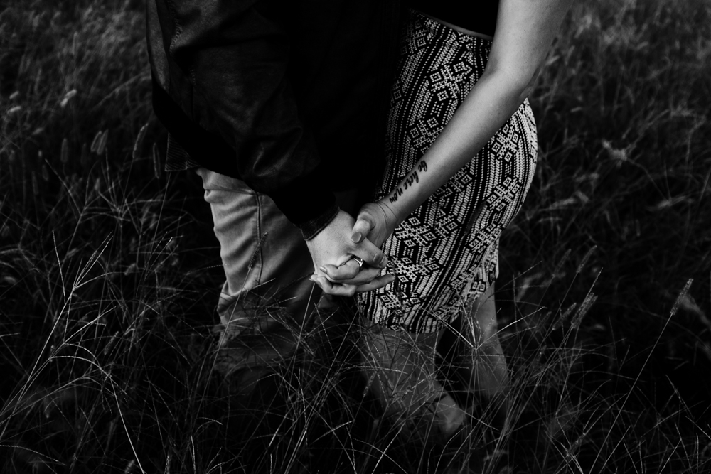 beautiful-moody-intimate-couple-holding-hands-field-tattoo-forever-21-river-west-arabia-mountain-atlanta-georgia-wedding-photographer