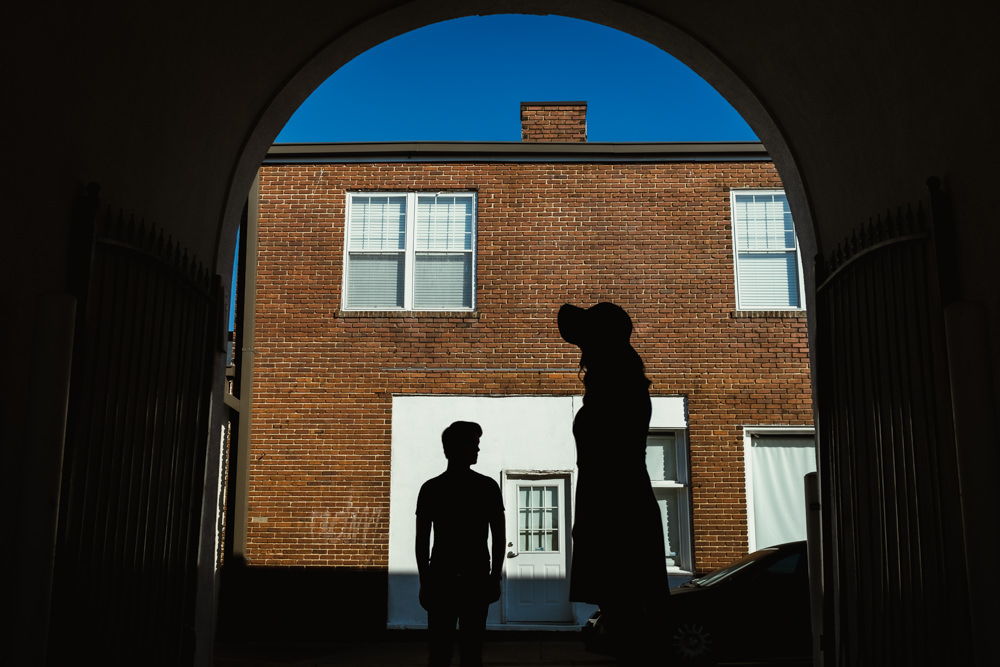 couple-silhouette-london-street-brick-house-cool-emily-steve-cole-marietta-square-atlanta-georgia-wedding-photographer