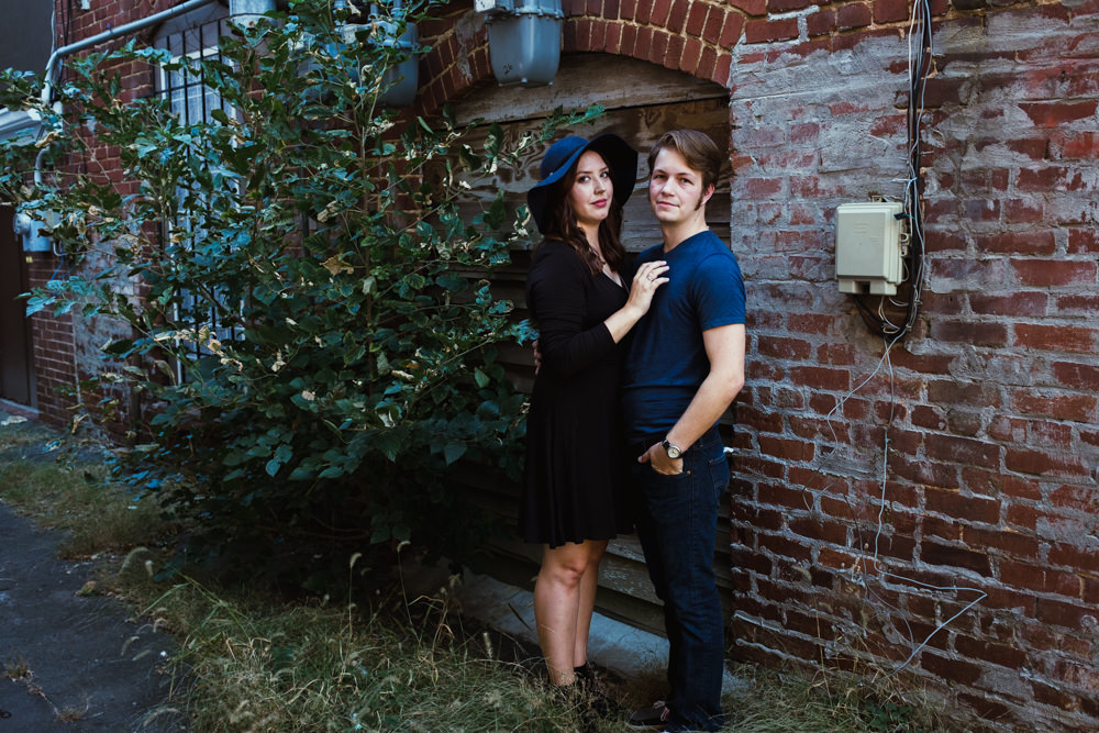 cute-couple-pose-alley-brick-green-emily-steve-cole-marietta-square-atlanta-georgia-wedding-photographer