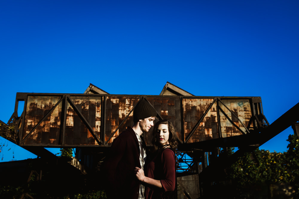 abandoned-factory-rusty-cool-portrait-fashion-model-couple-geordan-newsome-dillan-moore-goat-farm-atlanta-georgia-wedding-photographer
