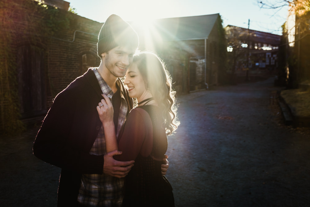 adorable-happy-sun-flare-abandoned-fashion-model-couple-geordan-newsome-dillan-moore-goat-farm-atlanta-georgia-wedding-photographer