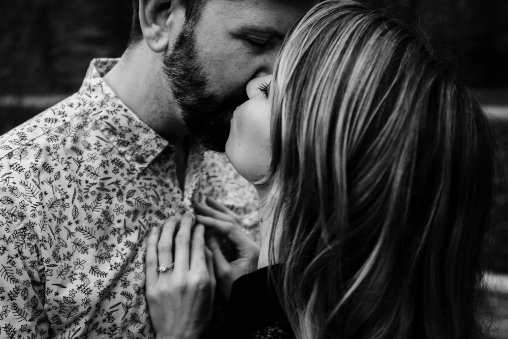 beautiful-couple-kiss-engagement-ring-black-white-moody-emotional-sarah-tyler-hander-sope-creek-atlanta-georgia-photographer