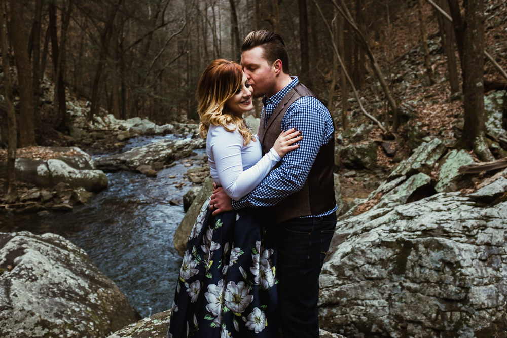 girl-smile-kiss-rocks-river-charlotte-russe-banana-republic-american-eagle-outdoor-couples-photo-shoot-cloudland-canyon-cody-bre-stephens-atlanta-georgia-photographer
