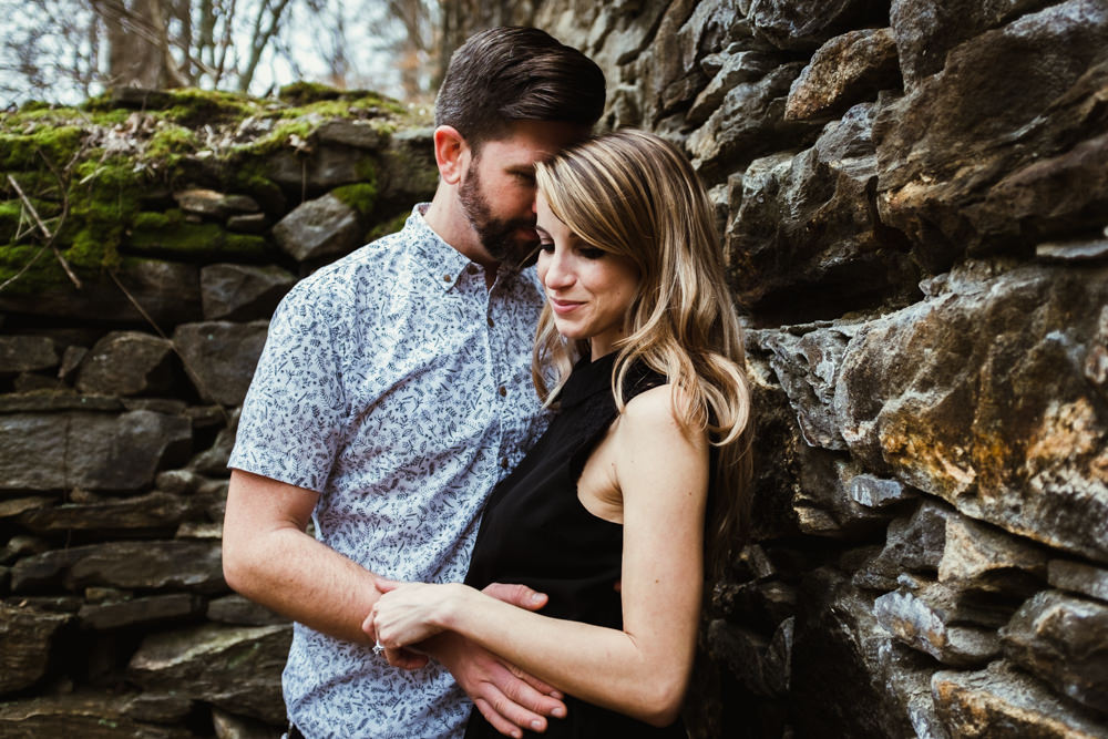 happy-couple-posing-stone-wall-photo-shoot-sarah-tyler-hander-sope-creek-atlanta-georgia-photographer
