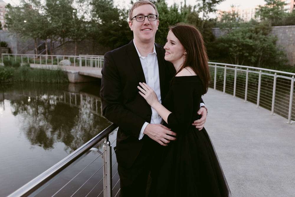 adorable-happy-couple-bridge-maggie-wolicki-lang-burghardt-engagement-photos-atlanta-wedding-old-fourth-ward-park