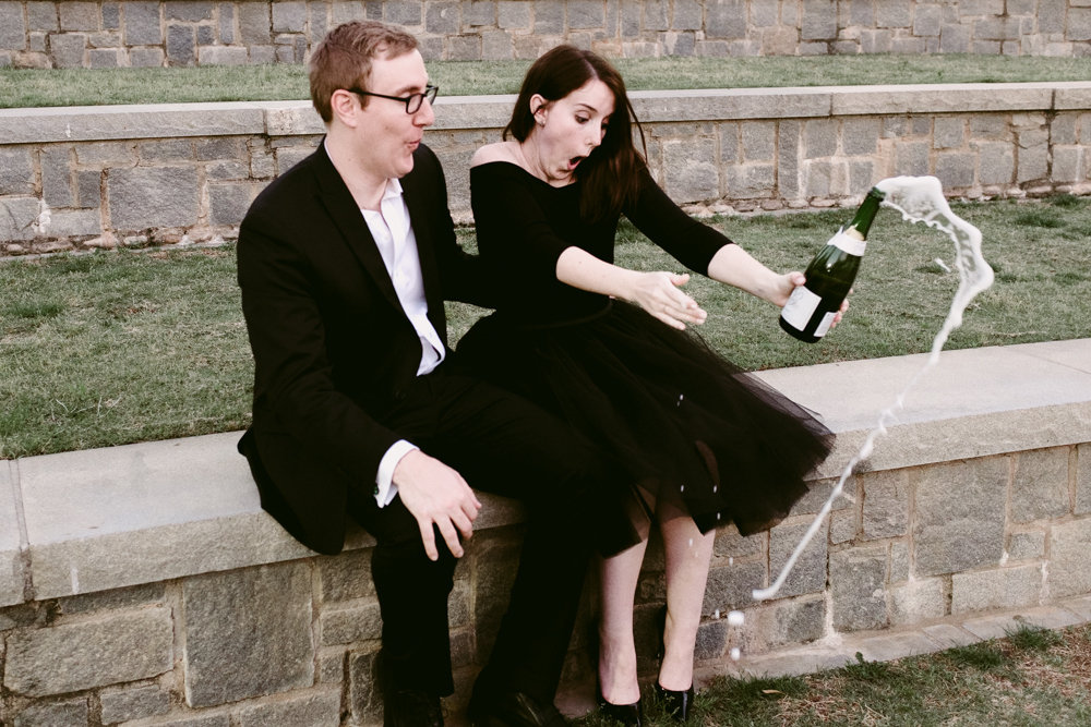 champagne-pop-funny-couple-cute-maggie-wolicki-lang-burghardt-engagement-photos-atlanta-wedding-old-fourth-ward-park