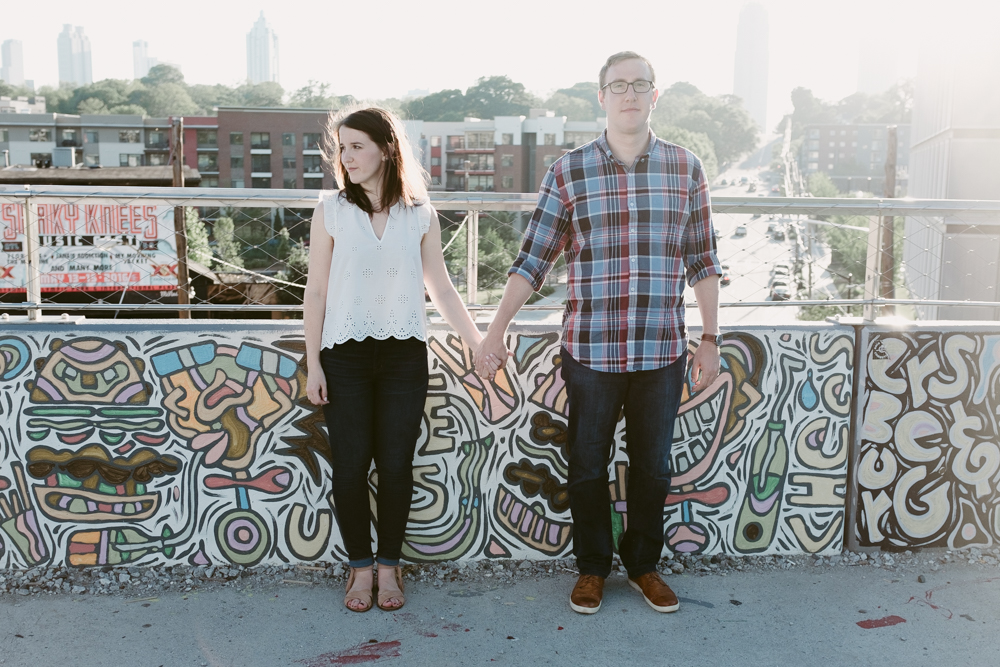 couple-pose-skyline-graffiti-maggie-wolicki-lang-burghardt-engagement-photos-atlanta-wedding-beltline