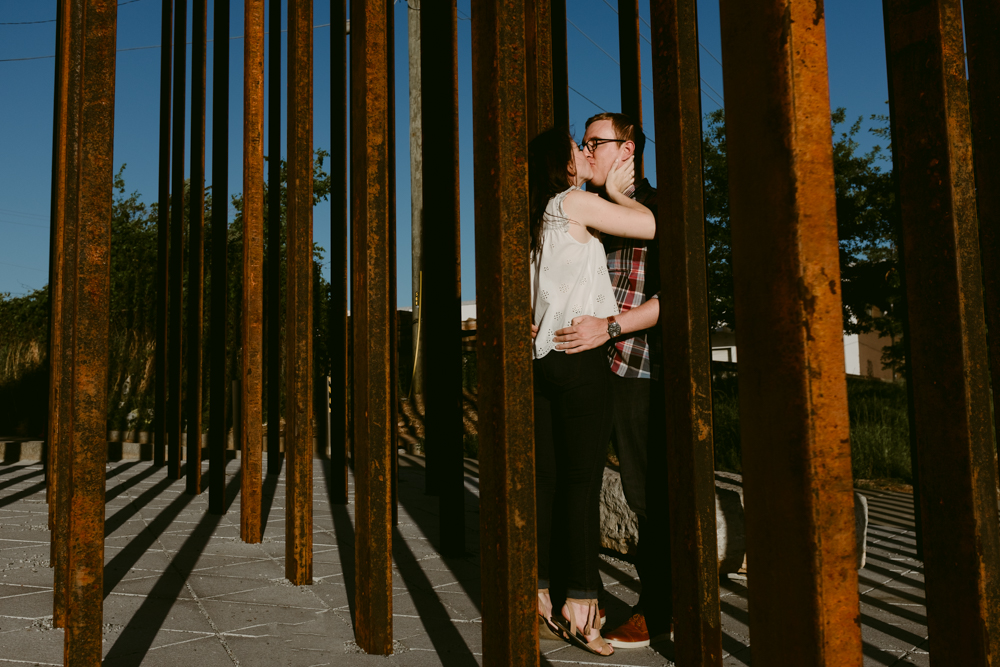 cute-kiss-couple-art-sculpture-light-shadow-maggie-wolicki-lang-burghardt-engagement-photos-atlanta-wedding-beltline