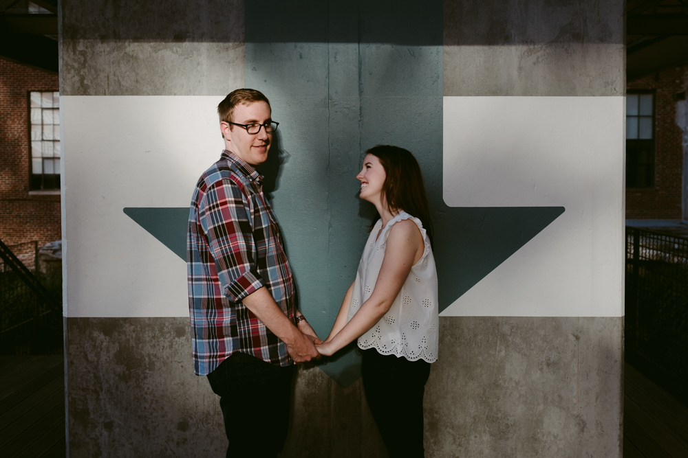 down-arrow-cute-pose-maggie-wolicki-lang-burghardt-engagement-photos-atlanta-wedding-ponce-city-market
