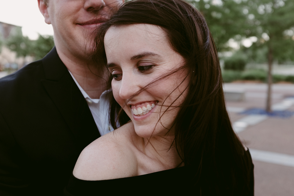 happy-smile-wind-in-hair-couple-maggie-wolicki-lang-burghardt-engagement-photos-atlanta-wedding-old-fourth-ward-park