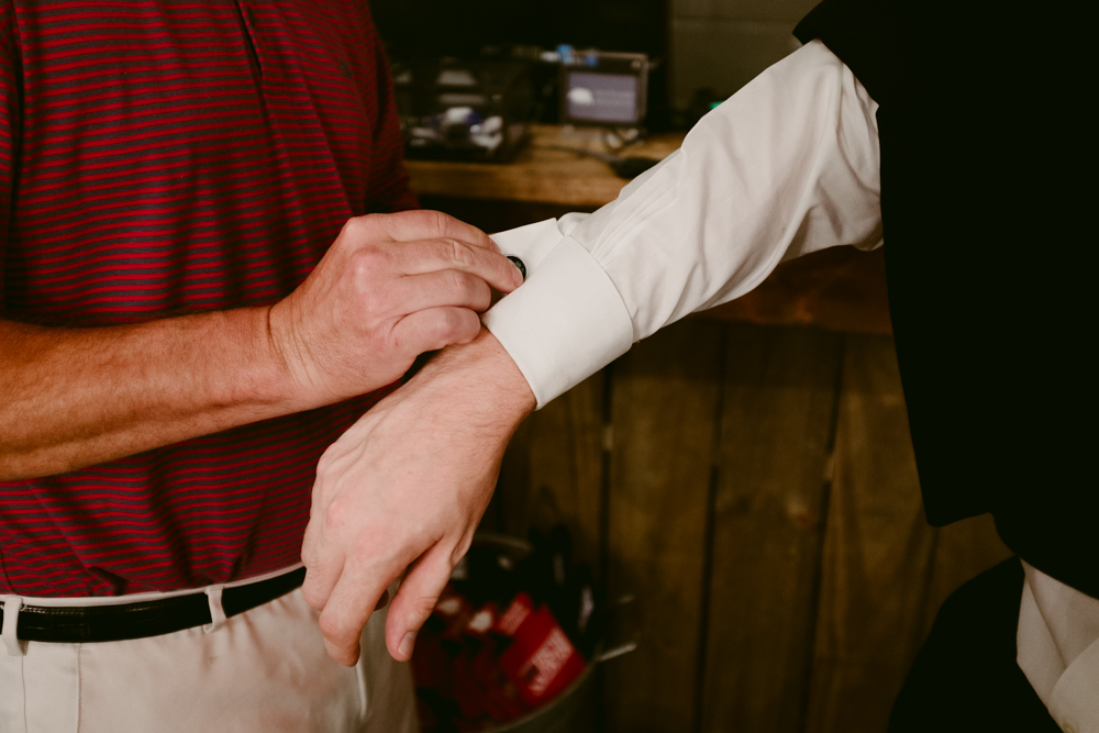 helping-with-cuff-links-maggie-wolicki-lang-burghardt-engagement-photos-atlanta-wedding-ponce-city-market