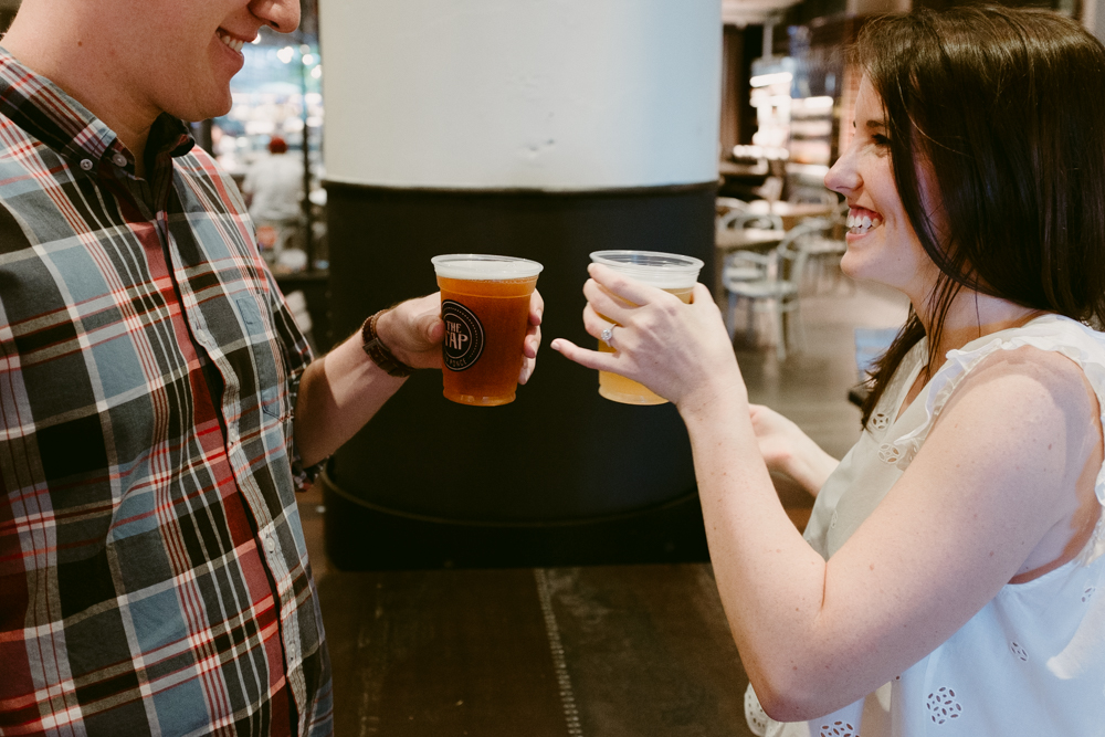 tap-beer-cheers-maggie-wolicki-lang-burghardt-engagement-photos-atlanta-wedding-ponce-city-market