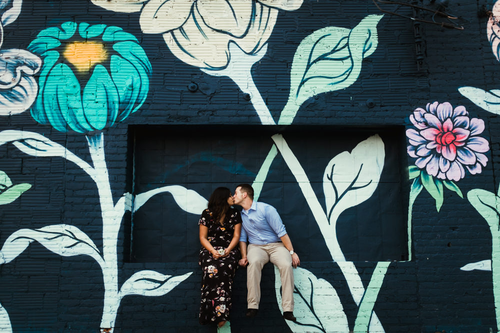 nisha-gajjar-charlie-chuck-beard-beltline-piedmont-park-atlanta-wedding-photographer-graffiti-patinging-flowers-wall-kiss