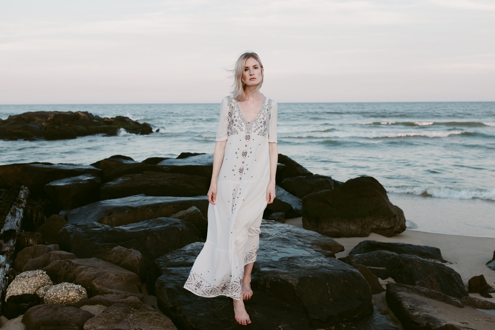 beautiful-model-beach-rocks-ocean-ashley-jensen-nj-wedding-photographer-asbury-park-ocean-grove