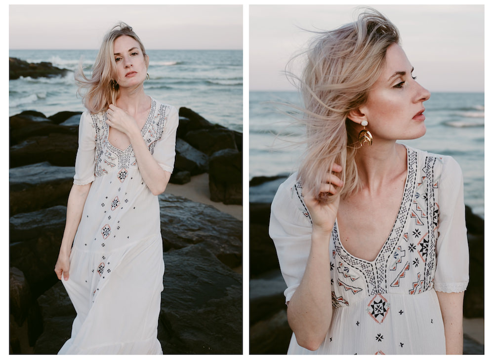 pretty-model-white-dress-beach-waves-wind-rocks-ashley-jensen-nj-wedding-photographer-asbury-park-ocean-grove